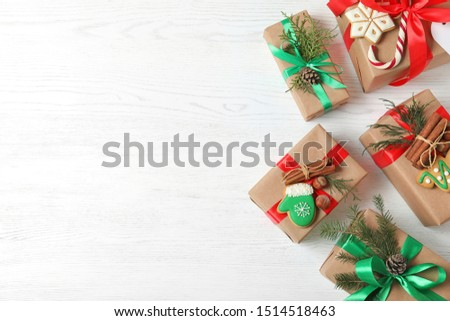 Flat lay composition with Christmas gift boxes on white wooden background. Space for text #1514518463