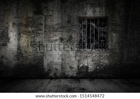 Window and rusty bars covered with cob web or spider web on prison old bricks wall and dusty floor, concept of horror and Halloween #1514548472