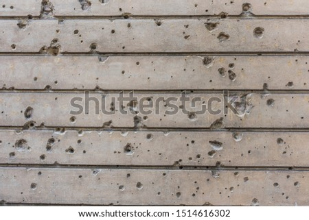 Bullet holds and damages on the wall in a building in Berlin, Germany #1514616302