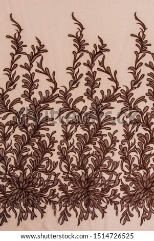 Texture lace fabric. lace on white background studio. thin fabric made of yarn or thread. a background image of ivory-colored lace cloth. Brown lace on beige background. #1514726525