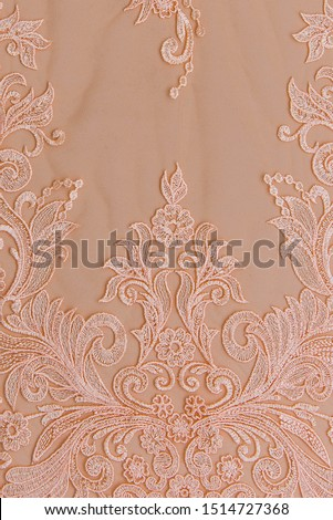Texture lace fabric. lace on white background studio. thin fabric made of yarn or thread. a background image of ivory-colored lace cloth. Pink lace on beige background. #1514727368