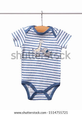 Baby bodysuit hanging on a clothesline isolated on white background/ Close-up/ Baby clothes #1514755721