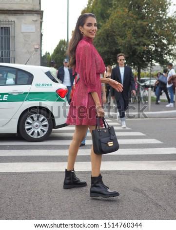MILAN, Italy: 18 September 2019: Fashion blogger street style outfit before Prada fashion show during Milan fashion week Spring/Summer #1514760344