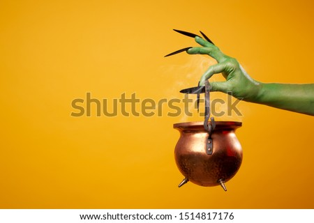 Image of green zombie hand with bowler hat. #1514817176