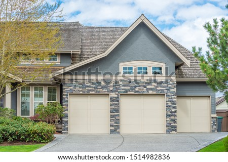Garage door in luxury house in Vancouver, Canada. #1514982836