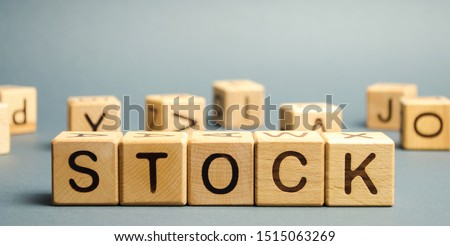 Wooden blocks with the word Stock. Trading on the stock exchange. Investment portfolio. Capital gains. Common and preferred stocks. Market trading and pricing. Share price determination. #1515063269