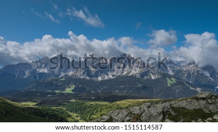 View of Sesto Dolomites massif &  a clear view of Tre Cime di Lavaredo iconic summits in Italy from the  Carnic Alps ridge & passes while trekking along the Carnic Peace Trail in Austria   #1515114587