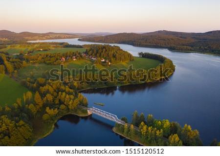 Lake Lipno. Czech countryside at lake Lipno. Houses and small railroad bridge crossing lake lipno near Sumava national park. Lake Lipno, czech republic. #1515120512