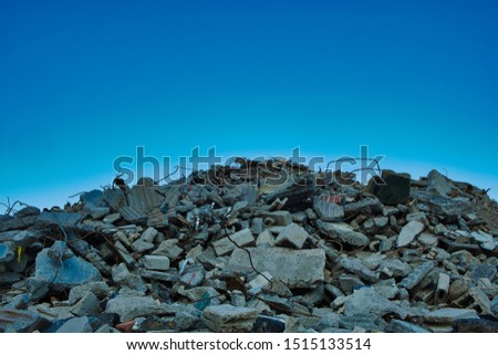 Was once a Building.Mountain or rubble composed of bricks and rebar from demolition of office building in Stamford Connecticut. Abstract, room for copy, horizontal. Royalty-Free Stock Photo #1515133514