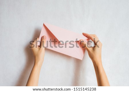 Woman holds in hand paper envelope. New mail, message. Postal service. Young girl want send or receive letter. Blank envelope, empty space. People communication concept. Envelope mockup closeup Royalty-Free Stock Photo #1515145238