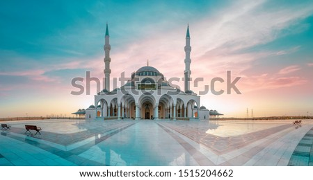 Sharjah Mosque Largest Masjid in Dubai, Ramadan Eid Concept background, Arabic Letter means: Indeed, prayer has been decreed upon the believers a decree of specified times, Travel and tourism image