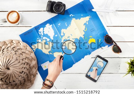 travel concept suitcase and worldmap over wooden table #1515218792