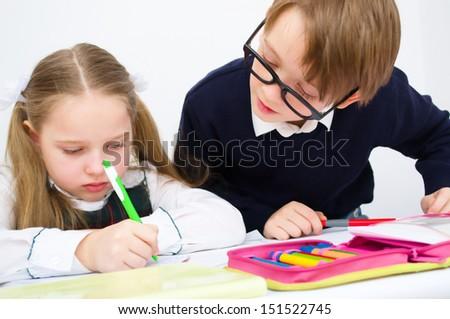 Little schoolchildren writing in workbook #151522745