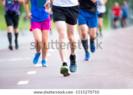 Marathon running race, people feet on city road #1515270710