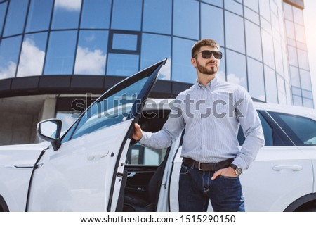 Handsome business man by the white car #1515290150
