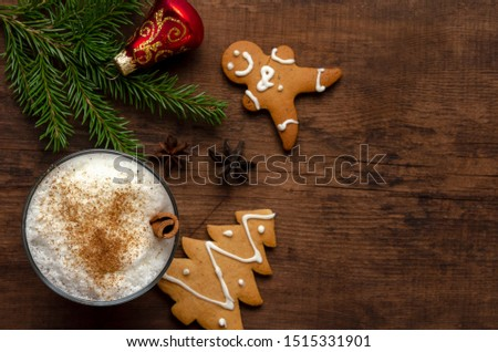 eggnog cocktail in with christmas decoration on old wooden table #1515331901