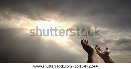 praying hands of a man for blessings his god on the sunset. People of all religions, Christians, Muslims, Buddhists humility their believed God and hope for life love  world peace, sun rays background Royalty-Free Stock Photo #1515472244