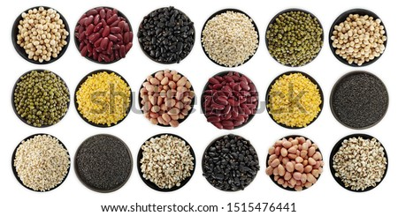 Mix nuts in black bowl on white background ,soy bean,green beans,red bean,black bean,peeled mung bean,peanut,barley,black sesame,pivot seeds #1515476441