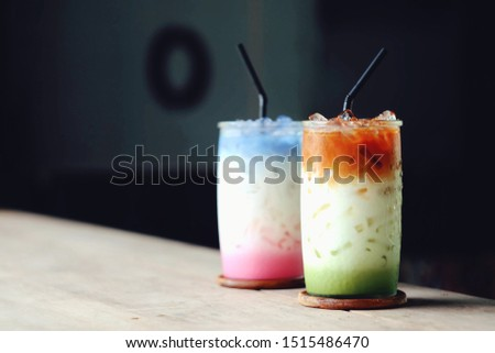close up glass of green tea on wood table, food and drink business, relaxation and lifestyle concept #1515486470