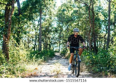 The man riding a bike in a mountain path #1515567116