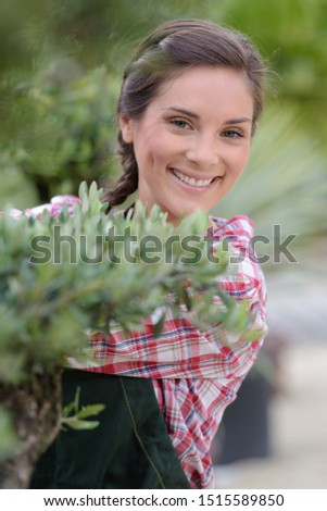 a female horticulture is smiling #1515589850