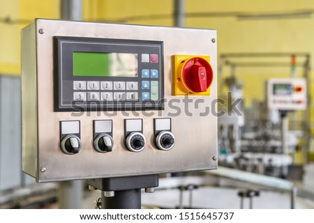 Conveyor control panel. The system of control and management of various equipment. The panel contains buttons, switches and LCD display. Royalty-Free Stock Photo #1515645737