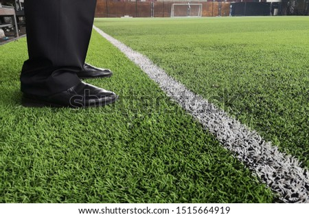 man wear Black leather shoe stand on grass floor. #1515664919