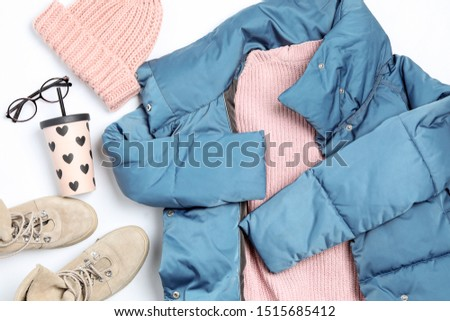 Set of stylish winter clothes on white background, top view