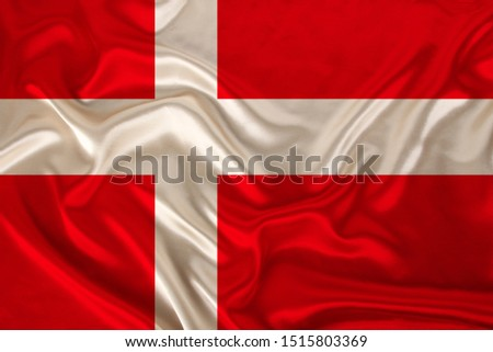 photo of the national flag of Denmark on a luxurious texture of satin, silk with waves, folds and highlights, close-up, copy space, concept of travel, economy and state policy, illustration #1515803369