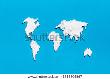 Planning a travel concept. Sketchy map of the world on blue wooden background top view #1515806867