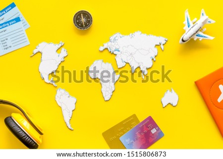 Planning a travel concept. Sketchy map of the world on yellow background top view #1515806873