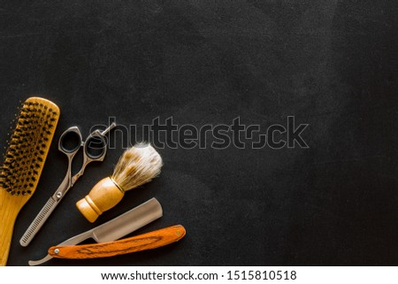 Men's hairdressing. Equipment on black background top view space for text #1515810518