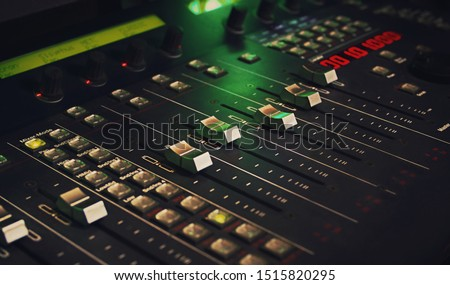 Close up at a mixer, DAW studio controller. Transport controller used usually on music or video production