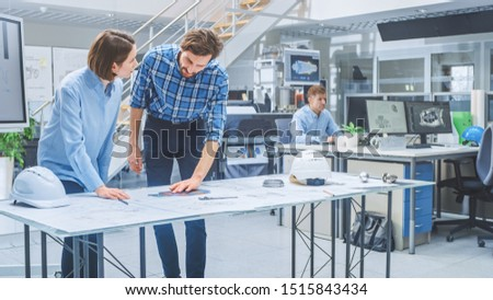 In the Busy Engineering Agency: Diverse Group of Engineers, Technicians, Specialists Working on Design for Industrial Engine Prototype. Professionals Talk, Work with Drawings, Use Computers #1515843434