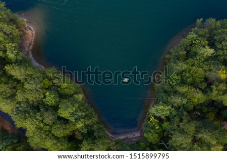 Two Kayakers hanging out in a cove in Carter Lake, Elijay, Georgia.  September 20, 2019.  Picture taken with a drone