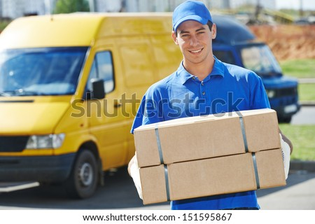 Smiling young male postal delivery courier man in front of cargo van delivering package #151595867