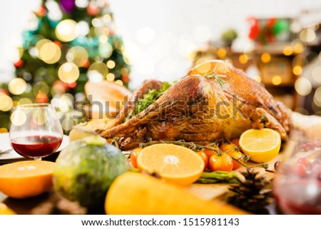 Roasted  chicken or turkey with sauce and grilled autumn vegetables: corn,pumpkin  on wooden table, top view, frame. Christmas or Thanksgiving Day food concept. #1515981143