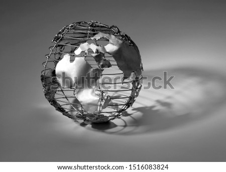A conceptual pic of a metal representation of the earth