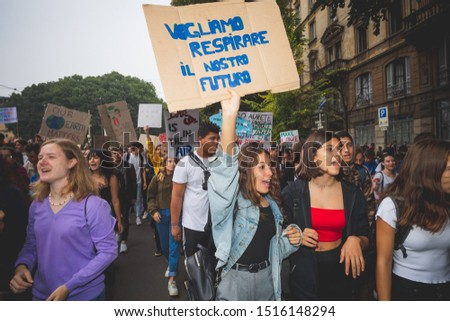 """Milan, Italy – September 27, 2019: Students holding """"We wanbt to breathe our future"""" picket sign at """"Fridays for Future"""" strike in downtown Milan #1516148294"""
