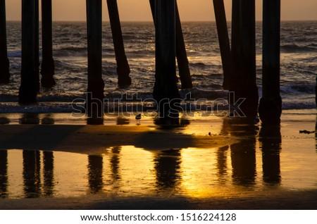 under the  Huntington Beach pier at sunset #1516224128