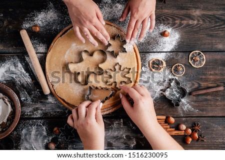 Christmas bakery. Friends making gingerbread, cutting cookies of gingerbread dough, view from above. Festive food, cooking process, family culinary, Christmas and New Year traditions concept #1516230095