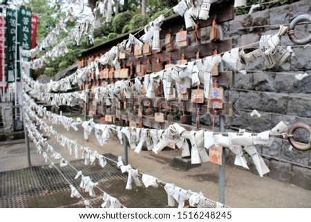 KAWAGOE, JAPAN -SEP 14: Close up fortune teller paper of japanese tied on rope  on SEP 14,2019 in KAWAGOE,SAITAMA,JAPAN. #1516248245