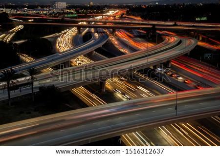Heavy rush hour traffic blurred on the Orange Crush interchange with the 5 freeway, 22 freeway and 57 freeway in Orange CA #1516312637