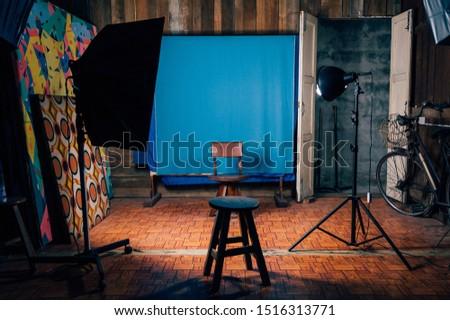 Vintage empty photo studio with lighting equipmentInterior of old style studio at Thailand