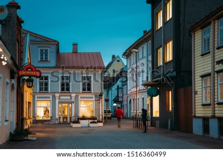 Parnu, Estonia - December 14, 2017: Night View Of Puhavaimu Street With Old Buildings, Houses, Restaurants, Cafe, Hotels And Shops In Evening Night Illuminations. #1516360499