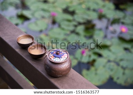 Outdoor close shot of tea sets and this can be used as tea elements or tea background. The Chinese on the pot means fortune. #1516363577