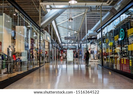 Brisbane, Queensland, Australia - 26th September 2019: People shopping in DFO discount factory outlet #1516364522
