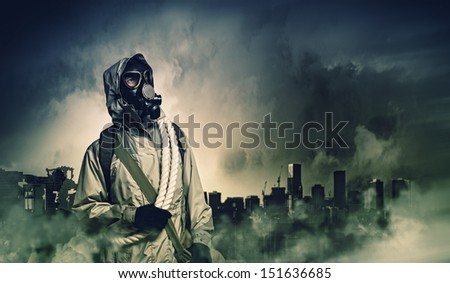 Man in gas mask against disaster background. Pollution concept #151636685