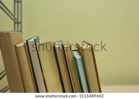 Books on shelf in library #1516489442
