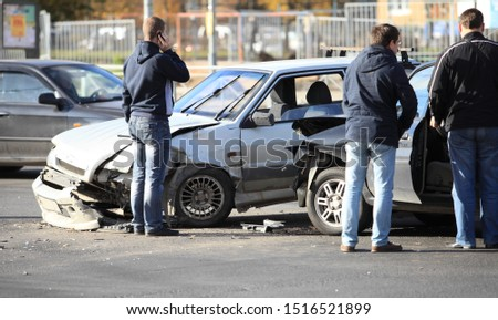 St. Petersburg  Russia  October 12, 2013 clash of two cars at the crossroads, unrecognizable people stand near crashed cars #1516521899